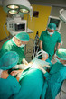 Surgeon and his team working on a patient