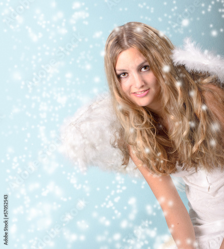 Merry Christmas: happy female angel with snow