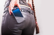 cell phone in girl's back pocket