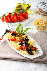 Pasta with olives, capers and tomatoes