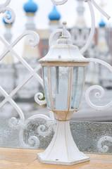 White outdoor lantern under the rain