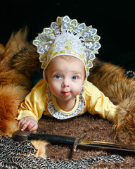 Baby, fox pelt and sword
