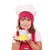 little girl cook with colorful cupcake portrait