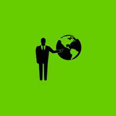 Businessman pointing to the globe on green background