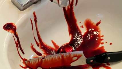 Knife and Blood dripping down into sink drain horror
