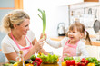 mother and kid  having fun preparing healthy food