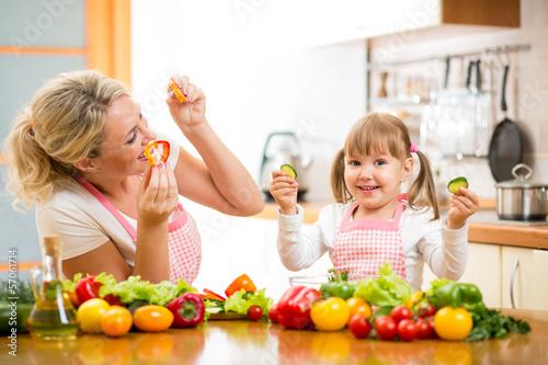 mom and kid preparing healthy food