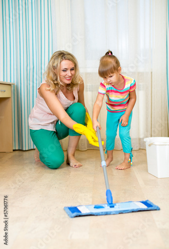 mother and kid clean room and having fun