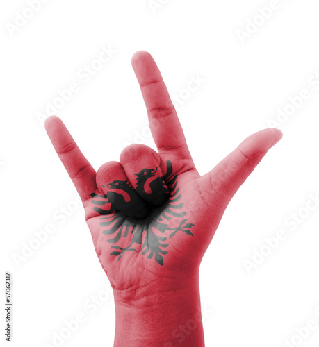 Hand making I love you sign, Albania flag painted