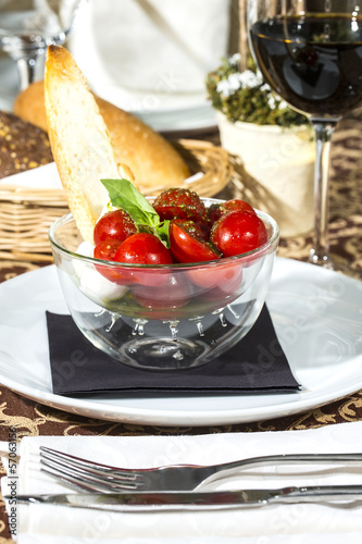 tomatoes and cheese in a glass bowl