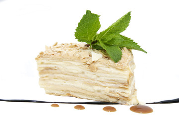 piece of layer cake decorated with mint