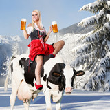 crazy tiroler or oktoberfest woman in the snow with beer