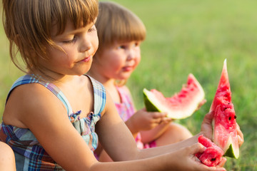 Girls eat sweet and tasty water-melon