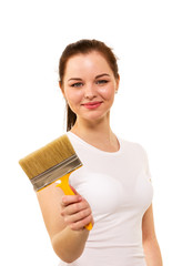 The beautiful girl with brush in hand it is isolated on the whit