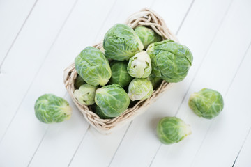 Fresh brussels in a wicker tray, view from above