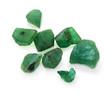 Leinwandbild Motiv Raw green emerald precious gemstones on the white background.