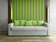 Leather sofa with green pillows