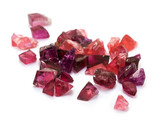 Raw uncut purple tourmaline gems on the white background.