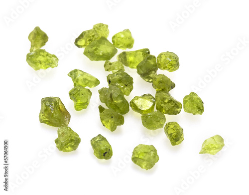 Raw green peridot gemstones on the white background.