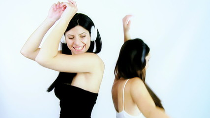 Two young women having fun dancing