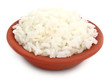 Fresh rice on a brown bowl over white background