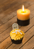 Pumpkin Halloween cupcake and candle close-up