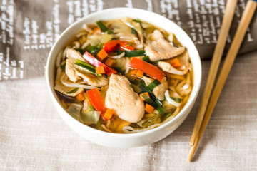 Bowls of Asian soup noodles and vegetables