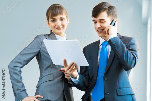 two business partners discussing reports