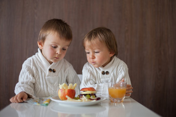 Boys, eating fruit sandwich