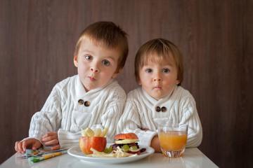 Boys, eating fruit sanwich