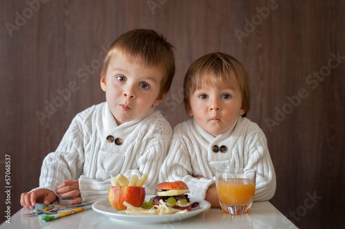 Boys, eating fruit sanwich
