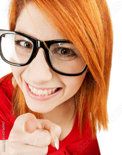 woman in glasses pointing finger