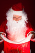Portrait of santa looking in sack
