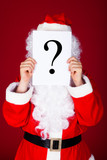 Santa holding question mark in front of his face