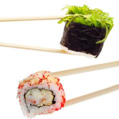 Single sushi roll in tempura and gunkan chuka and chopsticks