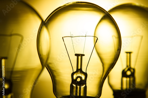 Row of light bulbs on a bright yellow background