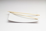 Chopsticks on white dish