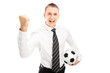 Smiling man with tie holding a soccer ball