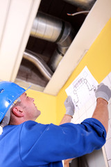 Engineer examining ventilation system