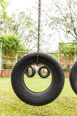 Smile Tyre swing in garden playground