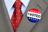 Vote badge on tan suit