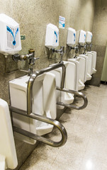 Urinals ,A collection of 5 urinals in a men's bathroom with the