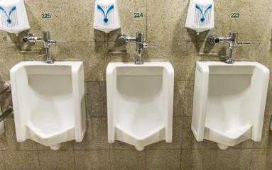 Urinals ,A collection of 3 urinals in a men's bathroom