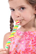 Girl sucking lolly pop