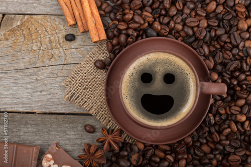 Fotobehang Cafe Coffee cup with spices and chocolate on wooden table texture
