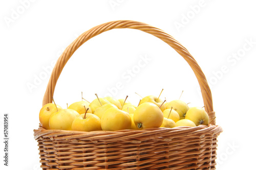 yellow apples in a wicker basket