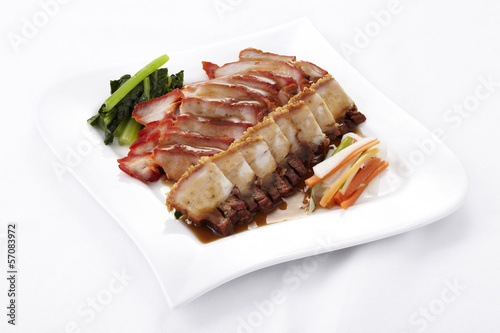 Chinese style roasted pork on white background
