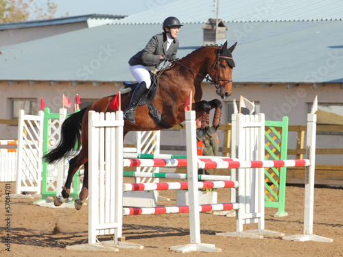 Show jumping rider clears the rails during an equestrian event