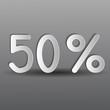 бумажные пятьдесят процентов на сером фоне