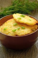 Potato pancakes in brown bowl